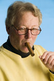 Cigar smoking middle age man Stock Photos