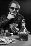 Cigar smoking poker player Stock Images