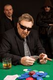 Cigar smoking whisky drinking poker player Stock Photography
