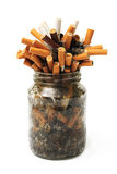Cigar stubs in jar Stock Image