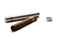 Cigar and tube. Havana cigar lying beneath it's tube royalty free stock photo