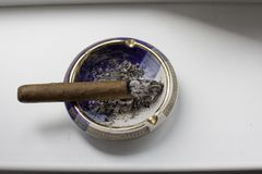 Cigar on vintage ashtray Stock Image
