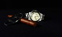 Cigar and watch with black background Stock Photo