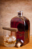 Cigar and whiskey Royalty Free Stock Images