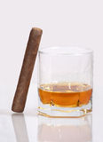 Cigar and whiskey. Cigar and a glass of whiskey on a white background Royalty Free Stock Photography