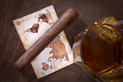 Cigar and whiskey. Cigar whiskey and old maps Stock Photos
