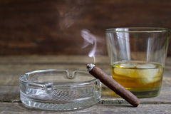 Cigar and whiskey abstract retro still life Stock Images