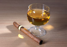 Cigar and whiskey cup Royalty Free Stock Images