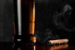 Cigar and whiskey on dark background Royalty Free Stock Photo
