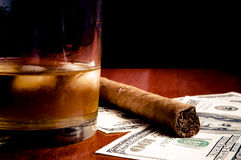 Cigar, whiskey and Dollars Stock Image
