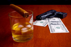Cigar, Whiskey, Dollars and handgun Stock Photos