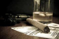 Cigar, Whiskey, Dollars and handgun Stock Images