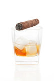 Cigar and whiskey with ice. Royalty Free Stock Photography