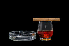 Cigar and whisky. With ashtray  on a black background Royalty Free Stock Image