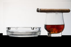 Cigar and whisky. With ashtray  on a white background Stock Photos