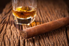 Cigar and whisky on old wooden table Royalty Free Stock Image