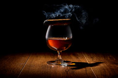 Cigar on wineglass Royalty Free Stock Photography