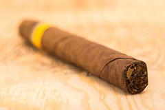 Cigar on a wooden board Royalty Free Stock Photos