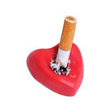 Cigaret stub. In heart isolated on a white background Royalty Free Stock Photo