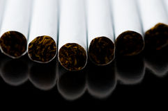 Cigarets. At the black background Royalty Free Stock Photo