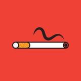 Cigarett på röd bakgrund Arkivfoto