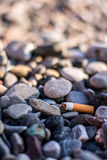 Cigarett på stranden Royaltyfri Bild