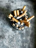 The cigarette. Many cigareets in the pot Stock Image