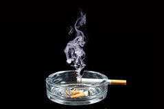 Cigarette. Many cigarette butt in the trash barrel Royalty Free Stock Photography