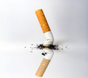Cigarette. Stub of a cigarette and its reflection Royalty Free Stock Photography