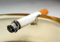 Cigarette. And smoke close up in ashtray Royalty Free Stock Images