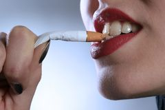 Cigarette. A beauty girl is pulling the cigarette 2 Royalty Free Stock Image