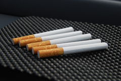 Cigarette. A stock of cigarette on black dot Royalty Free Stock Photos