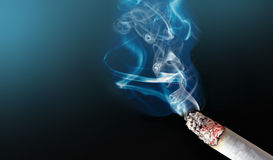 Cigarette. On black background with close shot Stock Images