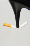 Cigarette. Crushed by the heel of a shoe Stock Image