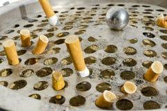 Cigarette in aluminium bin l Royalty Free Stock Images