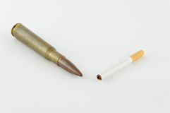Cigarette and ammunition on white background Stock Photography
