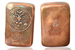 Cigarette antique copper. Cigarette made of copper with a monogram of Russian Empress Alexandra Feodorovna was made by Carl Faberge Stock Photo