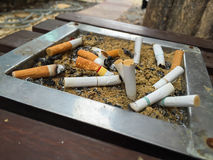 Cigarette ash and butts Stock Photography