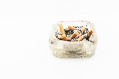 A cigarette with ash end rests Royalty Free Stock Photos