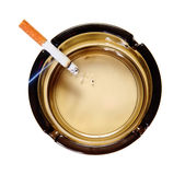 Cigarette in ash tray Royalty Free Stock Images