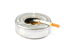Cigarette on ash tray Royalty Free Stock Photo