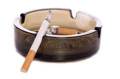 Cigarette and ash tray Stock Images