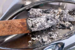 Cigarette ashes in a metal ashtray Royalty Free Stock Photo