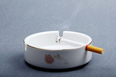 Cigarette on the ashtray. Royalty Free Stock Images