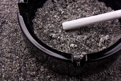 Cigarette in ashtray Stock Image