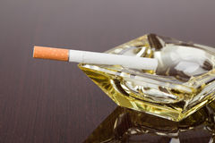 Cigarette and ashtray Royalty Free Stock Image