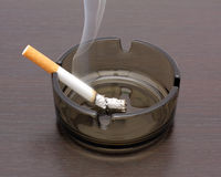 Cigarette in an ashtray. Smoking a cigarette in an ashtray Stock Photo