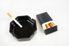 Cigarette in an ashtray Stock Photos