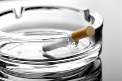 Cigarette on ashtray Stock Photo
