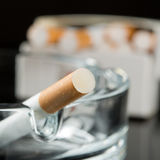 Cigarette on ashtray Stock Image
